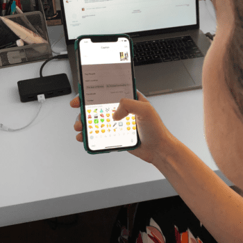 Woman selecting emoji from keyboard