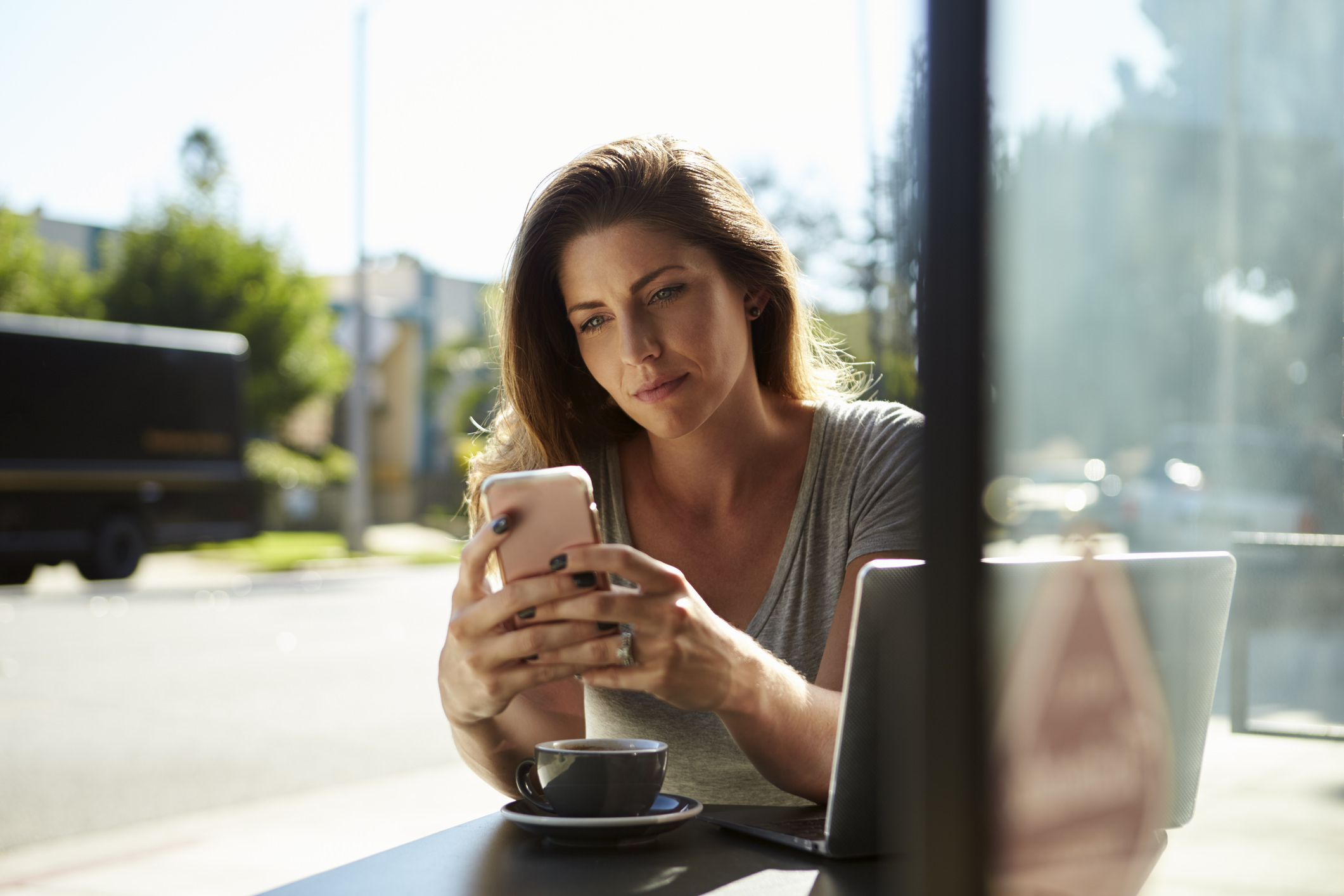 Woman using an app on her phone. Apps are a great way to reduce stress and promote mindfulness at work.
