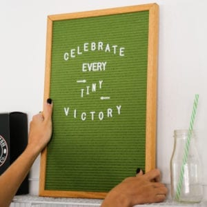 """Green letterboard reading """"Celebrate every tiny victory."""""""