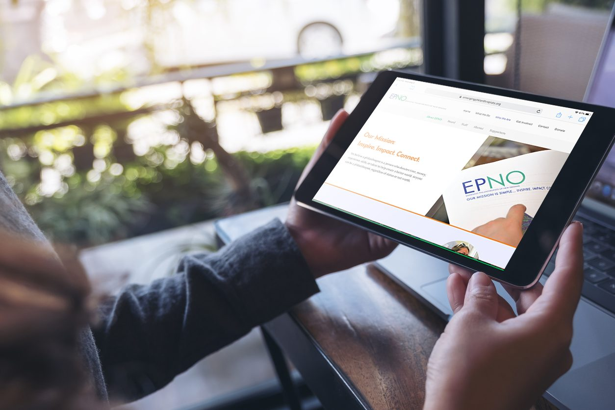 Person uses EPNO's new website on a tablet