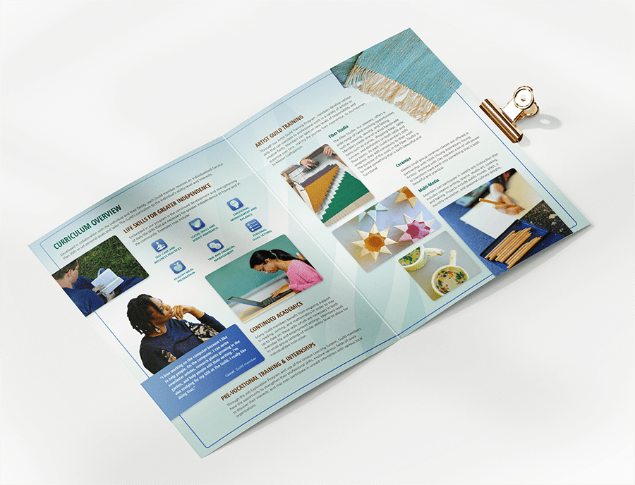 The Guild's packet open to a spread on curriculum and other programs